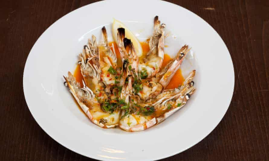 'Split open and generously smothered': grilled prawns and piri piri sauce.