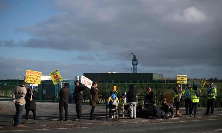 Protesters stand outside Cuadrilla's Preston New Road fracking site near Blackpool, Lancashire.