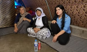 Rainas Elias, with her mother and grandmother in their tent in Khanke IDP camp near Dohuk