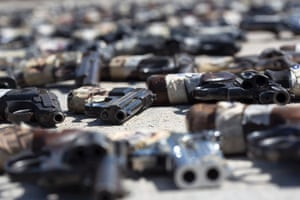 Hundreds of firearms, obtained through seizures and from citizens during Mexico's firearm exchange program, are on display.