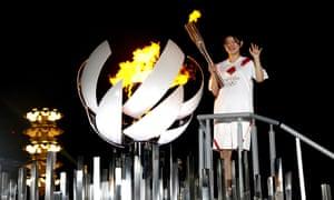 Olympic gold medalist Ayaka Takahashi relights the cauldron.
