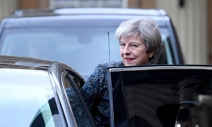 Theresa May gets into her ministerial car.