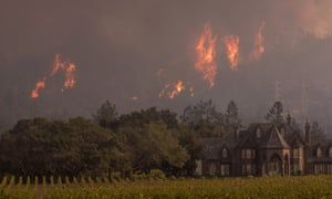 Flames rise behind a winery in northern California. The fires have killed at least 42 people.