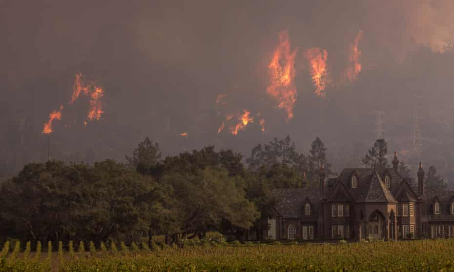 Flames rise behind Ledson Winery in October 2017 in Kenwood, near Santa Rosa, California.