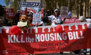 Demonstrators protest against the government's housing bill.
