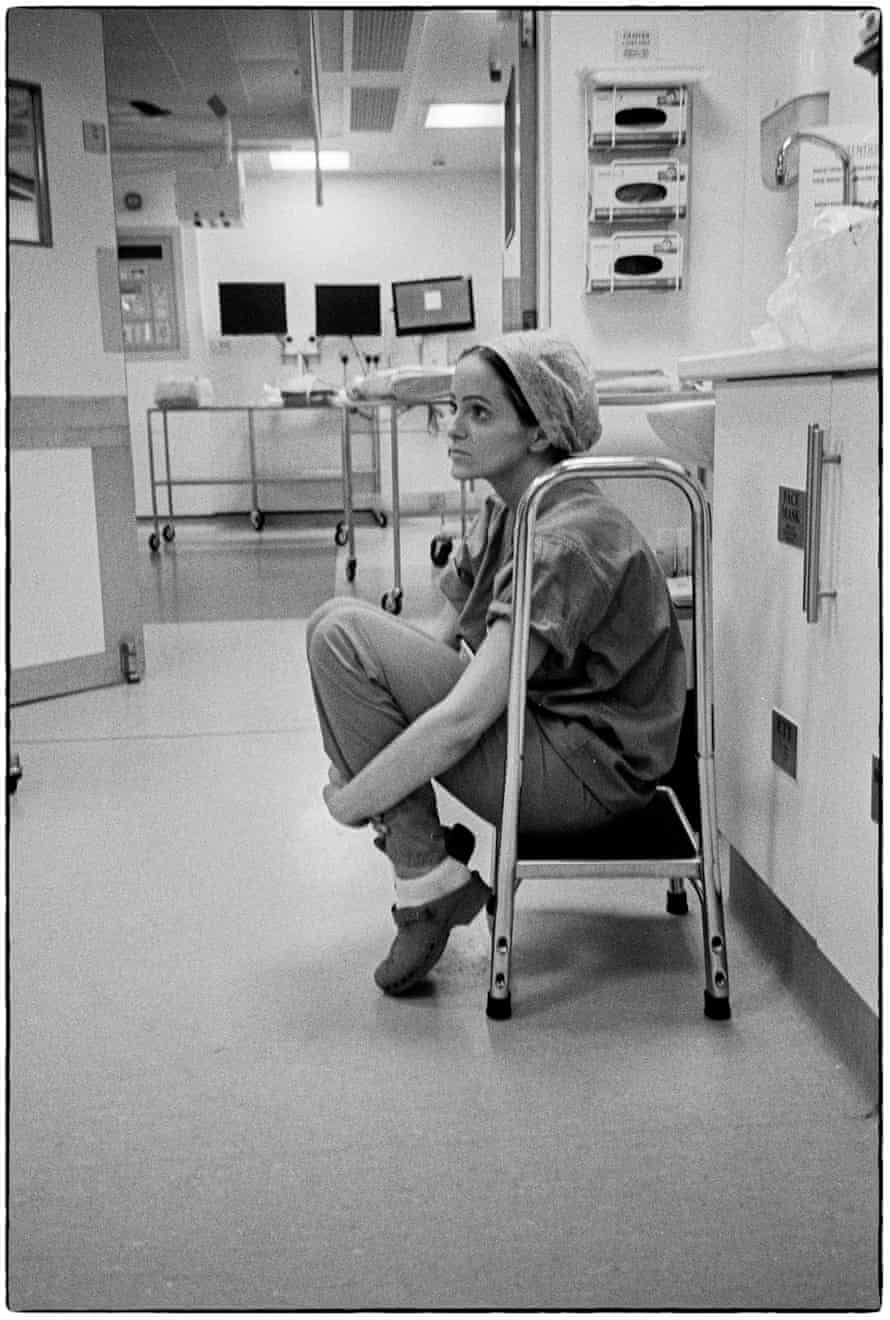 A staff member is seen at Nevill Hall hospital in Abergavenny