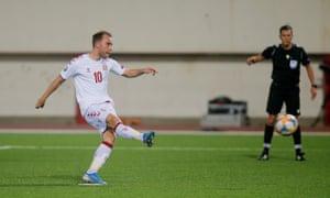 Denmark's Christian Eriksen scores their third goal from the penalty spot.
