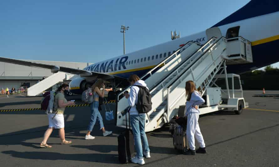Passengers wearing face masks board a Ryanair plane at Paris-Beauvais airport.