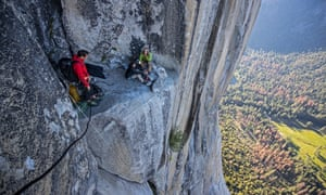 Alex Honnold meeting a couple climbers as he rappels El Capitan's Freerider route to practice on the climb before his free solo attempt in Free Solo
