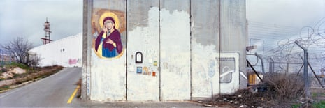 Occupied Palestinian Territories, January 2018A Madonna painted on the separation wall next to the entrance checkpoint of Bethlehem. Soldiers regularly erase graffiti which is painted next to the checkpoint, though the icon was not painted over