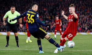 Liverpool's Harvey Elliott is challenged by Arsenal's Gabriel Martinelli, who asks referee Andre Marriner to give Liverpool a penalty.