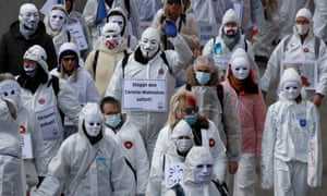 Protesters dressed in white take part in a demonstration against the ongoing Covid-19 restrictions.