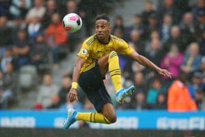 Aubameyang jumps to control the ball.