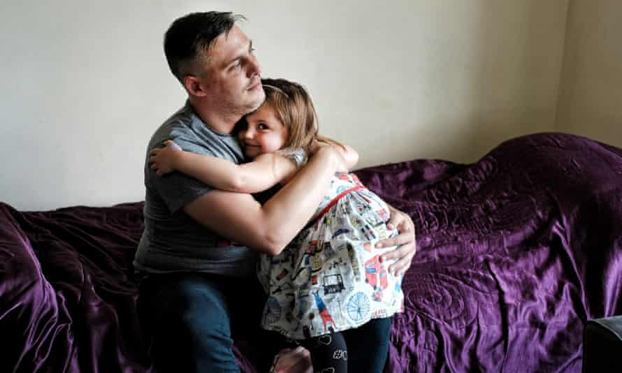 Single parent Anthony Lyman with his daughter Florence, at his flat in Northampton.