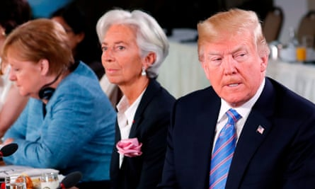 Trump attends a G7 and Gender Equality Advisory Council meeting on 9 June, with IMF Managing Director Christine Lagarde and German Chancellor Angela Merkel