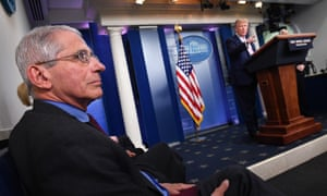 United States President Donald Trump stands as Director of the National Institute of Allergy and Infectious Diseases at the National Institutes of Health Dr Anthony Fauci listens during the Coronavirus Task Force briefing at the White House in Washington, DC.