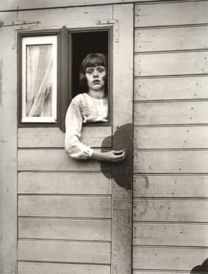 Girl in Fairground Caravan, 1926–1932Sander sought to present all aspects of German society including those images that challenged the social status quo.