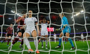 Despair for England's Nikita Parris after she has a first half penalty saved by the foot of German keeper Merle Frohms.