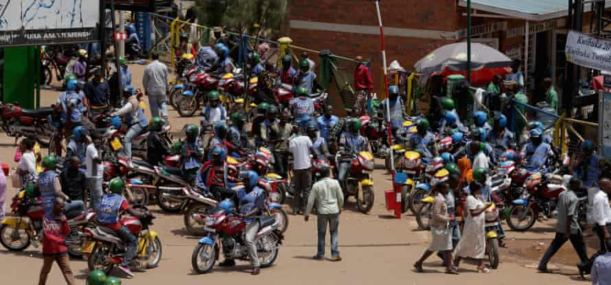 Motorbike taxis and passengers in Kigali