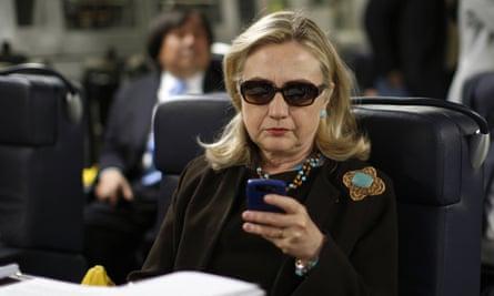 Hillary Clinton checks her phone.