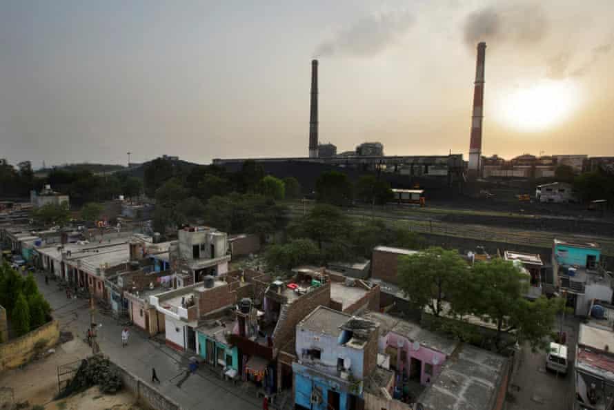 A coal-fired power plant near residential property in Badarpur, Delhi, India