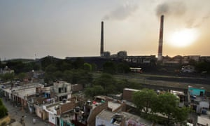 Emissions billow from smokestacks at a coal-fired power plant in Badarpur, Delhi, India