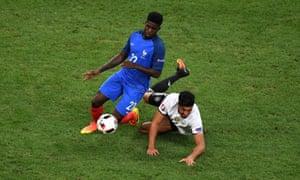 Samuel Umtiti sees off Emre Can.