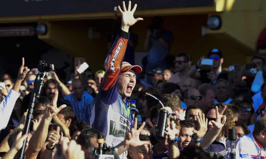 Movistar Yamaha's Spanish rider Jorge Lorenzo celebrates winning the Valencia Grand Prix and the 2015 MotoGP world championship title.