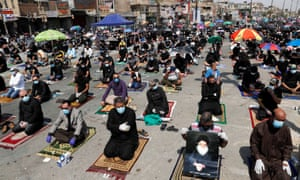 Supporters of Iraqi shia cleric Moqtada al-Sadr maintain social distancing as they attend Friday prayers for the first time in months