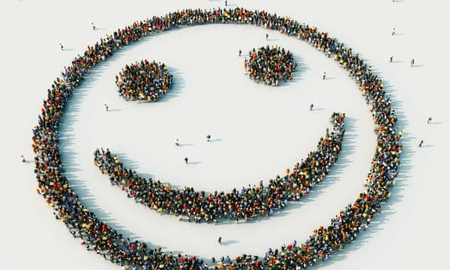 Aerial view of crowd of people arranged in smiley faceP26-GettyImages-134367121