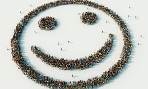 Aerial view of crowd of people arranged in smiley face