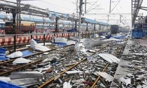 Debris litters the tracks at the railway station in Puri, Odisha state, India.