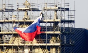 Russian flag being removed from scaffolding