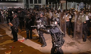 Riot police arrive to disperse protesters from the Legislative Council building.