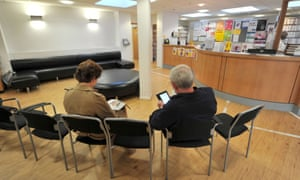 Patients in the waiting room of a GP surgery