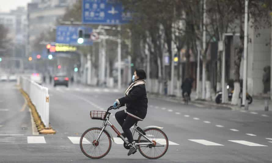 Cyclist in Wuhan, China, 27 January 2020.