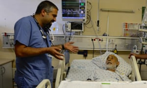 Rashad Rizeq talks to one of his patients