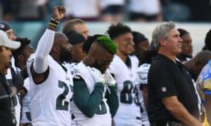 Philadelphia Eagles defensive back Malcolm Jenkins (27) raises his fist during the national anthem