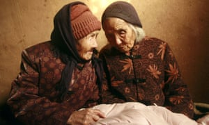 Chinese 104-year-old twins, Cao Daqiao (senior, R) and Cao Xiaoqiao talk at home in Weifang, east China's Shandong province on November 29, 2009. According to the Shanghai Guinness World Records, this twin sisters, who were born in 1905, are the oldest living twins in the world as they are also listed on the Guiness World of Records for the oldest twins.  CHINA OUT AFP PHOTO (Photo credit should read STR/AFP/Getty Images)