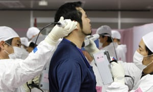 A worker is screened for radiation at Fukushima