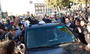 Iran's foreign minister, Mohamad Javad Zarif, greets his supporters as he arrives from Lausanne, Switzerland to Mehr-Abad airport in Tehran on Friday.