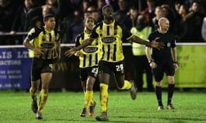 Dagenham & Redbridge Ayo Obileye's celebrates scoring his side's third goal against Whitehawk.