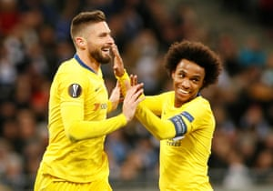 Giroud celebrates scoring his second goal with Willian.
