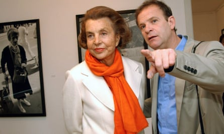 Liliane Bettencourt with François-Marie Banier in 2004, who was convicted of exploiting her in 2015.