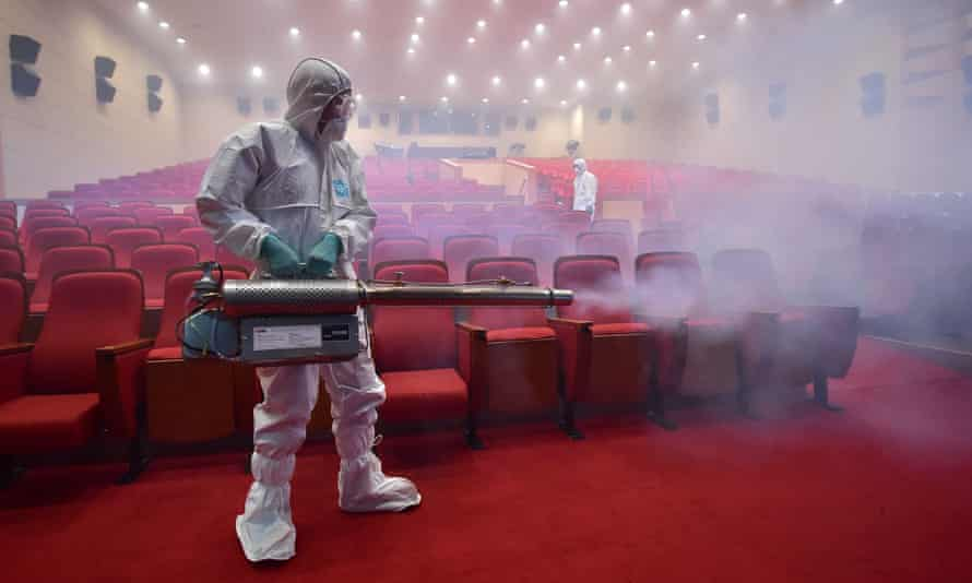 A worker fumigates a cinema in Seoul, South Korea, during the Mers outbreak in 2015