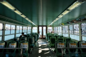 Empty water buses are seen in St. Mark's Square in Venice