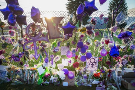 Mementos left by fans are attached to the fence that surrounds Paisley Park, the home and studio of Prince in Chanhassen, Minnesota