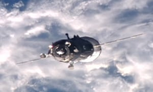 The Soyuz spacecraft seen above Earth while coming in to dock