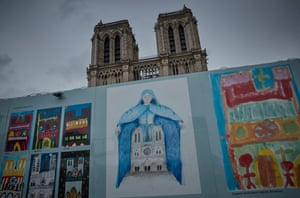 Children's artwork on display outside Notre-Dame Cathedral in Paris, France