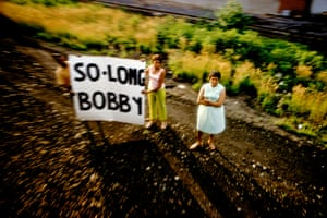 Mourners pay their respects as Robert Kennedy's funeral train passes, USA, 1968